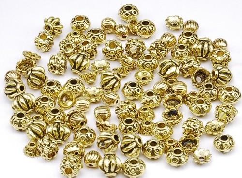 Metallperlen / Perlkappen Mix 96 Stück altgoldfarben